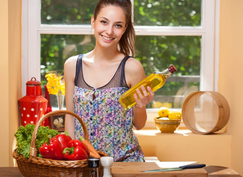 Fit Brunette Beauty Preparing Healthy Food in the Kitchen